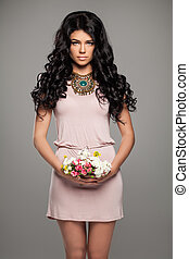 Romantic Brunette Woman in Pink Summer Dress and Flowers