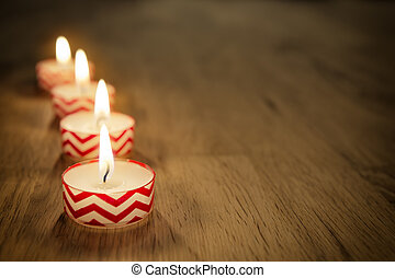 Romantic candles on wooden table