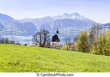 church Sankt Andreas with beautiful view to the Attersee in...