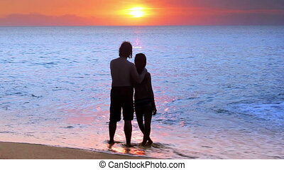 romantic couple at beach during sunset