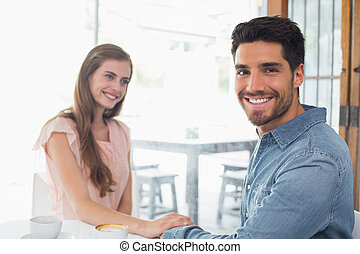 Romantic couple at coffee shop - Romantic young couple...