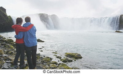 Romantic Couple At Godafoss Waterfall Iceland - Active People Healthy Lifestyle
