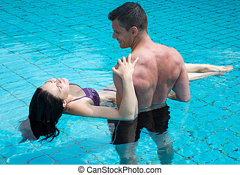 Romantic couple at swimming pool