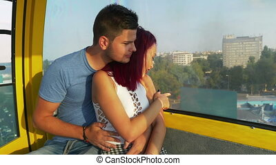 Romantic couple cuddling and having perfect time together in ropeway