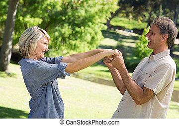 Romantic couple dancing in park