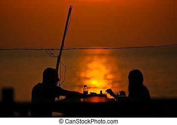 romantic couple dating at sun set
