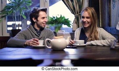 Romantic couple drinking tea at restaurant