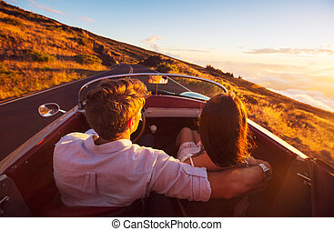 Romantic Couple Driving on Beautiful Road at Sunset