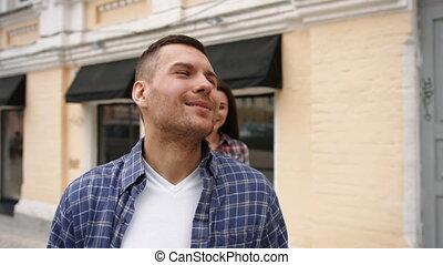 Romantic couple embracing in love laughing having fun.