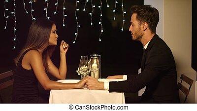 Romantic couple enjoying an evening dinner - Romantic sexy...