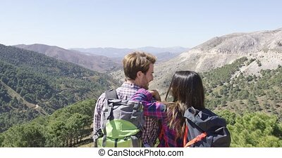 Romantic couple enjoying views - Back view of young romantic...