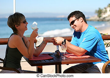 Romantic couple - Happy couple at a seaside cafe