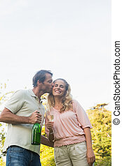 Romantic couple having champagne together