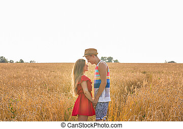 romantic couple holding hands in the field