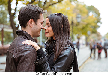 Romantic couple hugging outdoors