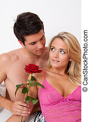Romantic couple in bed with Rose. Marry the man. - A...