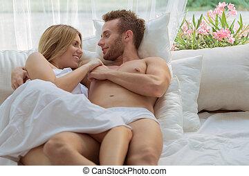 Romantic couple in bedroom