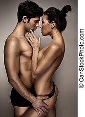 Romantic Couple In Lingerie standing sideways to camera with...