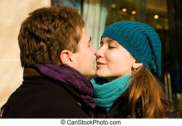 Romantic couple in love kissing outdoors