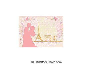 Romantic couple in Paris kissing near the Eiffel Tower.