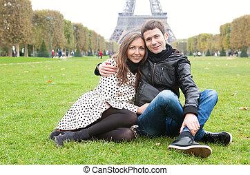 Romantic couple in Paris, near the Eiffel Tower