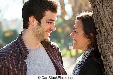 Romantic couple in park.