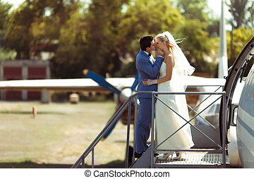 Romantic couple in the windy wedding day