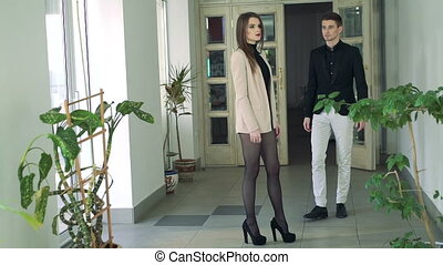 Romantic couple indoor. Caressing. In a background of white door. Slowly