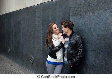 Romantic Couple Leaning On Wall