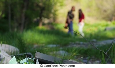 Romantic couple leaving a garbage dump in the forest Slow motion, beautiful cinematic shot Environmental problem Educational