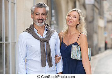 romantic couple looking at camera