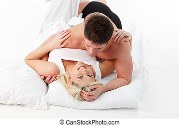 Romantic couple lying on bed