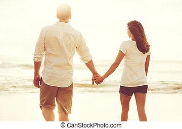 Romantic Couple on the Beach at Sunset.