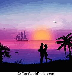 Romantic couple on the beach in beautiful seascape at sunset...
