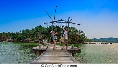 romantic couple on tropical pier