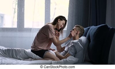 Romantic couple relaxing in bed in the morning