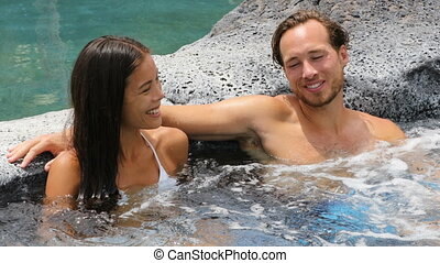 Romantic couple relaxing together in hot tub whirlpool...