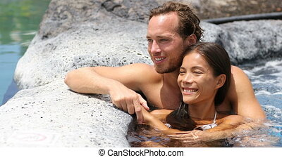 Romantic couple relaxing together romantic in hot tub...