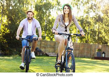 Romantic couple riding bikes