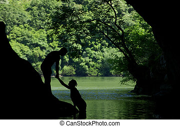 Romantic couple silhouette hand in hand in the outdoors