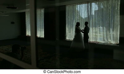 Romantic couple silhouette near the window. Wedding day.