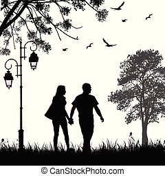 Romantic couple silhouette walking in the park