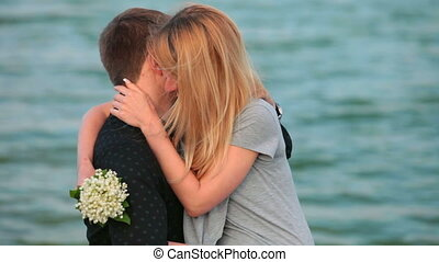 romantic couple - Romantic couple embracing against the lake
