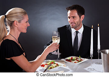 Romantic couple toasting each other - Romantic couple...
