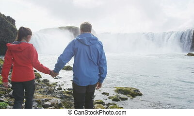 Romantic Couple Walking At Godafoss Waterfall - Active People Healthy Lifestyle