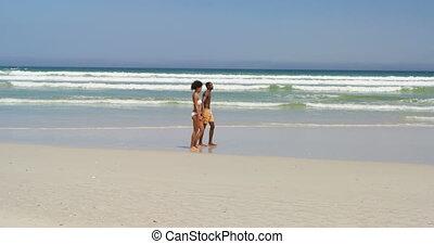Romantic couple walking hand in hand at beach 4k