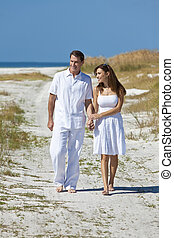 Romantic Couple Walking Holding Hands on An Empty Beach
