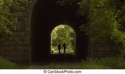 Romantic Couple Walking in a Tunnel