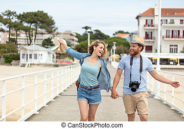 romantic couple walking on the pier