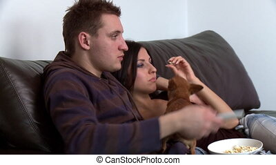 Romantic couple watching television